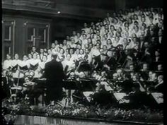 Beethoven, Ninth Symphony, Fourth Movement, conducted by Furtwängler April 19, 1942,  for Hitler's Birthday. Hitler was there. The choir sings of joy and love in the midst of the Holocaust.  Movie dates from a concert given eve of Hitler's 53rd birthday on 19 april 1942, but the sound is from another performance the month before 22 & 24 march with diff. cast. Rudolf Watzke sang all the performances; voices heard are Tilla Briem, soprano, Elisabeth Höngen, alto  Peter Anders instead of…