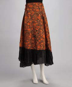 A lush swirl pattern adds undeniable beauty to this unique skirt. Fitted at the waist and made from 100 percent cotton, this gorgeous item is a true bohemian beauty.