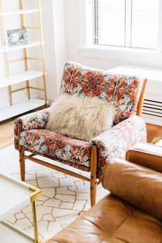 Cool printed mid century chair with sheepskin pillow.