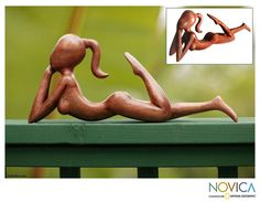 Enhance your home decor with the Daydreamer statuetteStatue depicts a girl, head in her hands, stretching out to daydreamWayan Rendah portrays the lissome girl in suar wood, as she lazily moves her leg in time to imagined music