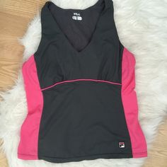 Fila work out / tennis top Too with built in bra. Size large but runs very small. Great condition, barely worn. Fila Tops Tank Tops