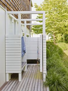 a private outdoor shower. Painted mahogany encloses the shower, which stands above an ipe deck.