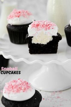 Snoball Cupcakes recipe.  These Snoball Cupcakes are full of nostalgia. Rich chocolate cupcakes, creamy filling, and a pillow of marshmallow frosting make them better than your favorite snack cake.