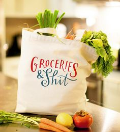 "Groceries & Shit Tote Bag This oversized, sturdy, screen printed canvas tote is the perfect bag for carrying all your groceries and shit. - Bag measures 18"" wid"