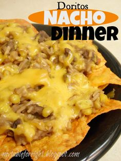 Doritos Nacho Dinner,    ground beef,    water,    box Mexican style Rice-A-Roni,    can refried beans,    can whole kernel corn,    shredded cheddar cheese,   nacho cheese Doritos chips.