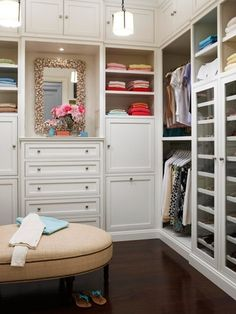 Conquer Closet Clutter  I would die for a closet like this. This is amazing. Shoe space, drawer space, shelf space... what more could you ask for? I love it!! This is what my closet would look like in my dream home.
