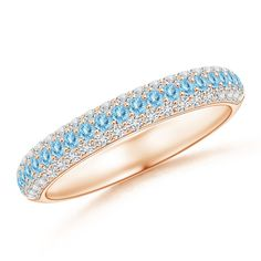 Show your lasting love with this beautiful half eternity aquamarine and diamond three-row wedding band in rose gold.
