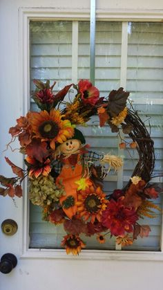 I would take the scarecrow out and put a burlap bow at the top