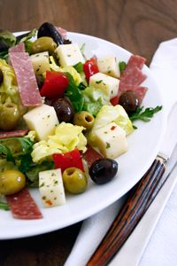 Provolini Antipasti Salad—boasting black and green Manzanilla olives, creamy cubes of provolone, sweet red peppers & savory button mushrooms. Partnered with Romaine & crunchy radicchio alongside a House Italian Dressing...