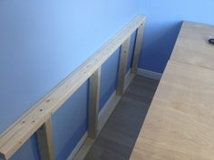 I built a wooden frame to support the plywood base for the bedframe.