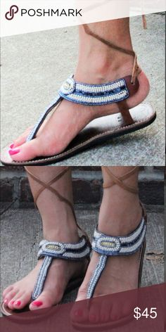 Swahili Strappy sandals The Famous Kichale Sandals made of shiny grey and milky white beads beautifully blend. The sandals lace up close to the knees. They are fashionable for beach walks. Imported and made of pure leather material. These sandals are so cool because of its style and neutral color suits various occasion this summer! Shoes Sandals