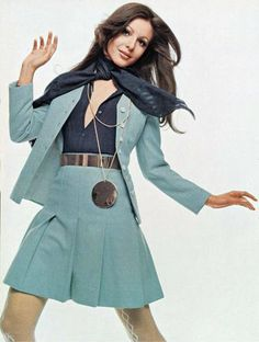 Model Ivana Bastianello 1969 Vogue late 60s early 70s light blue wool suit mini skirt pleated jacket sweater black blouse metal belt scarf hair charlie's angeles looks