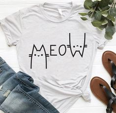 Meow Cat T Shirt Women's has O collar neck. Made of high quality cotton this colorful cat tee shirt is available in 6 different colors. You'll feel cool thanks to women's meow letter cat t shirt. Experience the new animal printed cat tee shirt fash Cute Tshirts, Funny Shirts, Tee Shirts, T Shirt Painting, Tshirt Painting Ideas, Diy Shirt, Cat T Shirt, T Shirt Art, Shirt Print