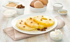 Ananas gratinato  DIFFICOLTÀ   TEMPO: 20 minuti PORZIONI: 6 persone  INGREDIENTI:  •1 ananas maturo •50 gr di uva sultanina 1• tuorlo d'uovo •2 albumi 30 gr di amido di mais Maizena •40 gr di zucchero di canna •100 ml di succo d'ananas •100 ml di panna da montare •1 cucchiaino di zenzero in polvere