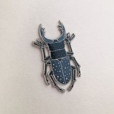 Stag Beetle pins by Caitlyn Stout Blue Beetle, Hard Enamel Pin, Cool Pins, Pin And Patches, Pin Badges, Lapel Pins, Pin Collection, Brooch Pin, Bracelets