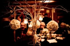 Branches with flowers & candles. I love this as a centerpiece. Gives off a great vibe