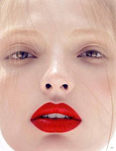 Red lip - nude eyes. Classic.