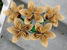Book flowers.  Great way to repurpose damaged books.