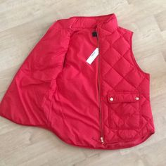 BRAND NEW WITH TAGS j crew puffer vest Red J. Crew puffer vest with tags! Purchased online and didn't fit. Petite Medium - so it's shorter than normal! Also posted on Merc for less. J. Crew Jackets & Coats Vests