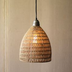 Warm, earthy light from this woven pendant.