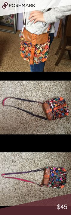 Purse Beautifully colored flower purse. Over the shoulder and the strap is adjustable. Moderately used but still in good condition. A perfect, roomy purse for the spring/summer season! Bags Crossbody Bags