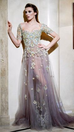 I can't find information on this dress but it is gorgeous.