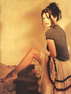 Catherine Zeta-Jones-- Skirt, legs, feet, dark nail polish, 1990s fashion, femininity, beauty, being woman!