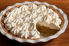 This eggnog pumpkin pie recipe has an easy press-in crust, a rich pumpkin and eggnog filling, and a thick layer of whipped cream on top.