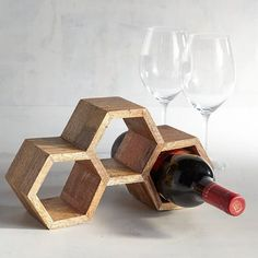 Isn't this sweet? Our stackable honeycomb wine rack, handcrafted of mango wood, is as rustic as it is modern. Buy this distinctive look for yourself—and get one for your wine-loving friend. Wood Wine Racks, Wine Glass Rack, Wooden Wine Holder, Diy Wine Racks, Wine Racks For Sale, Wooden Rack, Wine Rack Inspiration, Stackable Wine Racks, Wine Rack Design