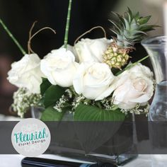 Centerpiece by Fleurish Floral Design | White Roses, White Trachelium, Curly Willow, Ornamental Pineapple, Hosta Leaves, and Dinosaur Grass