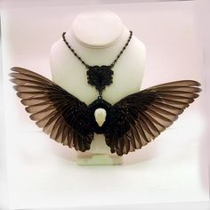 a necklace made with REAL taxidermy bird wings & a parakeet skull in the middle...so wrong