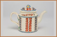 A gorgeous 18th Century Creamware teapot decorated with an unusual design in terracotta and blue. ENGLISH Circa 1775                 Height 5 1/2″