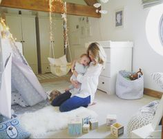 @huntersandheels with her gorgeous baby Ollie in the nursery. Ollie is wearing his MORI striped cardigan and leggings.