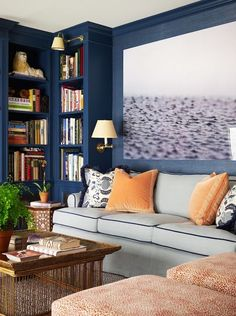 Navy and orange room with built-in shelving and perfect picture of raindrops hitting water.
