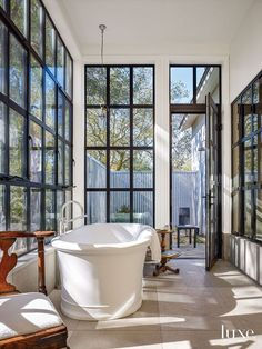 Designs by Sundown is a 2020 Gold List honoree featured in Luxe Interiors + Design. See more of this design professional's projects. Modern White Bathroom, Modern Bathrooms, Master Bathrooms, Beautiful Bathrooms, Small Bathroom, Architectural Materials, Aluminium Windows, Aluminum Windows Design, Steel House