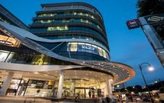 Plaza Singapura is a Retail Architecture and Interior Design development in Singapore by award winning architects, Benoy. Retail Facade, Shop Facade, Commercial Complex, Centre Commercial, Entrance Design, Facade Design, Mall Design, Retail Design, Mix Use Building