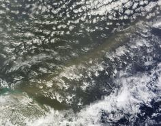 A long stream of dust and sand crossed the Atlantic Ocean in late June, 2014, bringing a tan haze to parts of South America and the United States.