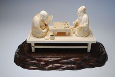 japanese okimono | Japanese ivory okimono of Hotei God of wealth playing the game gō ...