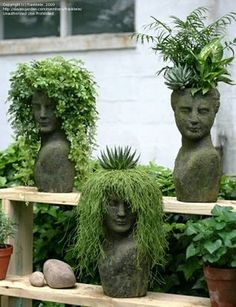 Plants in sculpture heads. Could use hair dressing mannequin heads and paint to suit environment