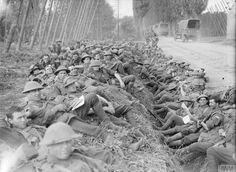 26 sept 1917 Australian troops probably from 11 th Australian Brigade 3rd Australian Division 11 th Australian machine Gun Company resting on their way to the front line during the Battle of Polygon Wood part of the Battle of Passchendale
