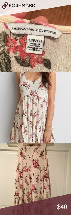 American Eagle Floral Babydoll Dress Light, flowy material with magenta and pink floral design. Perfect for spring/summer. American Eagle Outfitters Dresses Mini