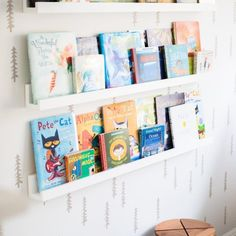 The clean, simple design of our Beaumont Book Ledge allows it to match with nearly any aesthetic. Add one to a bedroom, entryway or playroom for instant book storage that doesn't take up any floor space. Crate And Barrel, Floating Bookshelves, Wall Bookshelves Kids, Kids Book Shelves, Book Ledge, Book Wall, Nursery Bookshelf, Playroom Design, Playroom Ideas