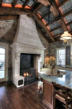 I want a giant fireplace next to my kitchen island. Look at the amazing ceilings!
