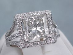 This is our sparkly 3.29 ctw Princess Cut Diamond Engagement Ring with a stunning 2.50 ct Princess Cut I-J Color/SI3 Clarity Clarity Enhanced (Fracture Filled and Laser Drilled) Center Diamond. It is set in a beautiful 18K White Gold Setting and listed for $9,990 on our website. I Love Jewelry, Modern Jewelry, Bridal Rings, Wedding Rings, Princess Cut Diamonds, Sterling Silver Bracelets, Diamond Engagement Rings, Wedding Jewelry, Jewelery