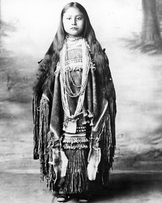 Native American prisoners of war 1886-1914 ~ Chiricahua Apache Girl in a puberty dress, Fort Sill, Oklahoma.