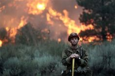 In this Monday, Aug. 2013 photo, a firefighter with the Idaho City Hotshots looks for spot fires during a back burn along the Pine-Featherville Road. Photos Of The Week, Great Photos, Cool Pictures, Wildland Firefighter, Anxiety Causes, Like A Rock, Male Photography, Amazing Photography, Sun Valley