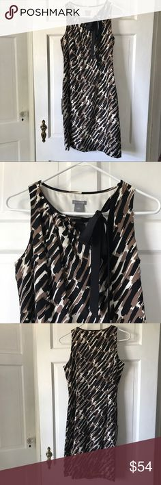 """💕NWT Ann Taylor Brown and Black Print Silk Dress New with tags! Brown and black strokes of color with ivory background and feminine black ribbon tie closer at neck.  100% silk, fully lined. Approximate measurements 17"""" armpit to armpit and 36"""" shoulder seam to hem. Ann Taylor Dresses"""