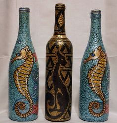 Hand painted wine bottles. Seahorse and Egyptian cat. Dot Art Creations.  Find more of my work: https://www.facebook.com/dotartcreations  https://www.etsy.com/shop/DotArtCreations