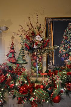 mantle- YUP I need new garland around my mantle.. hmmm.. wonder if I can find this and if HL still has Mr. Santa pic