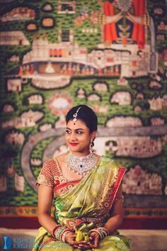 South Indian bride. Diamond jewelry.Green silk kanchipuram sari with contrast blouse.Braid with fresh flowers. Tamil bride. Telugu bride. Kannada bride. Hindu bride. Malayalee bride.